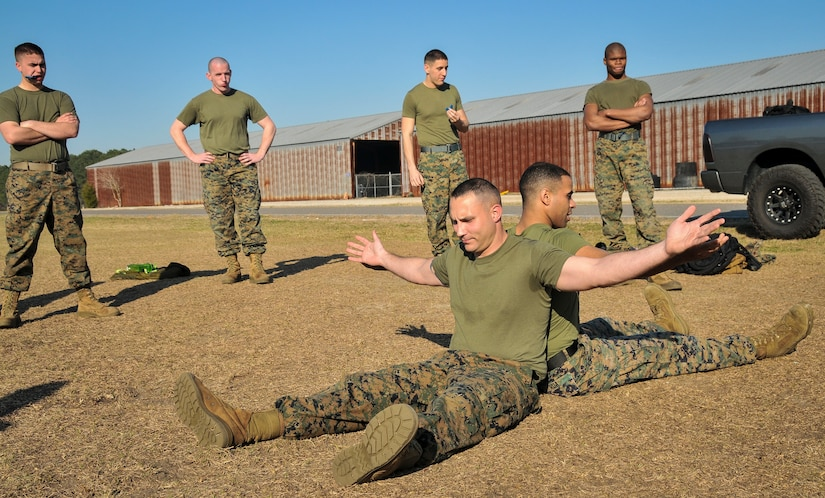 U.S. Marine Corps Sgt. Cody Prickett (left) and Cpl. Osvaldo Roa, Naval Consolidated Brig Charleston corrections specialists, are in the grapple starting position during a Marine Corps Martial Arts Program training Feb. 7, 2013, at Joint Base Charleston – Weapons Station, S.C. MCMAP is a hand-to-hand, close quarter combat and weapons training program designed to educate, improve technique and boost morale throughout the Corps. Marines stationed at the NCBC participate in MCMAP four times a week. (U. S. Air Force photo/Airman 1st Class Jared Trimarchi)