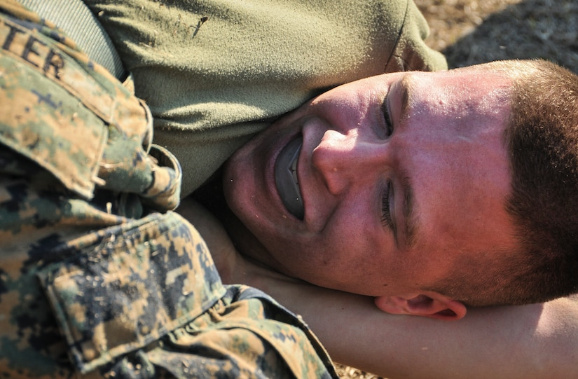 U.S. Marine Corps Lance Cpl. Robert Ireland, a Naval Consolidated Brig Charleston corrections specialist, is in a headlock during Marine Corps Martial Arts Program training Feb. 7, 2013, at Joint Base Charleston – Weapons Station, S.C. MCMAP is a hand-to-hand, close quarter combat and weapons training program designed to educate, improve technique and boost morale throughout the Corps. Marines stationed at the NCBC Brig participate in MCMAP four times a week. (U. S. Air Force photo/Airman 1st Class Jared Trimarchi)