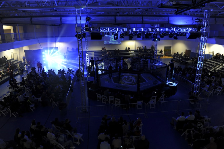 The crowd watches fighters at the Buckley MMA Fight Night Feb. 9, 2013, at Buckley Air Force Base.  This event was the first sanctioned mixed martial arts event on a Colorado military base.  (U.S. Air Force photo by Airman 1st Class Phillip Houk/Released)