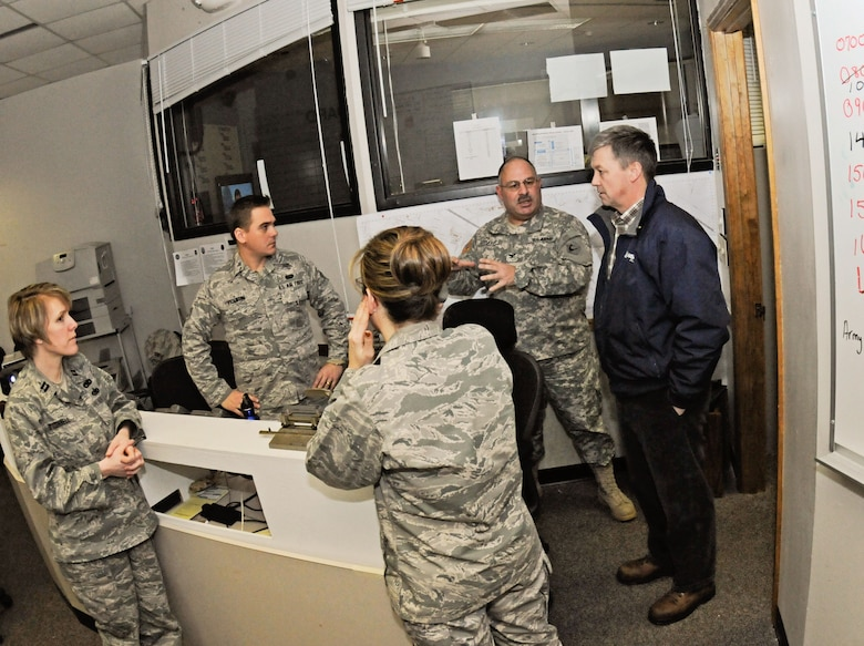 Craig Hallstrom, NStar president, speaks with members of the Emergency Operations Center, Otis Air National Guard Base, Mass. during a visit, Feb. 12. NStar Electric, a Northeastern utility company, is temporarily basing a large assembly of utility workers and vehicles here in order to more effectively restore electricity to the citizens of Cape Cod due to effects of the brutal winter storm that hit the area, 8-9 February.