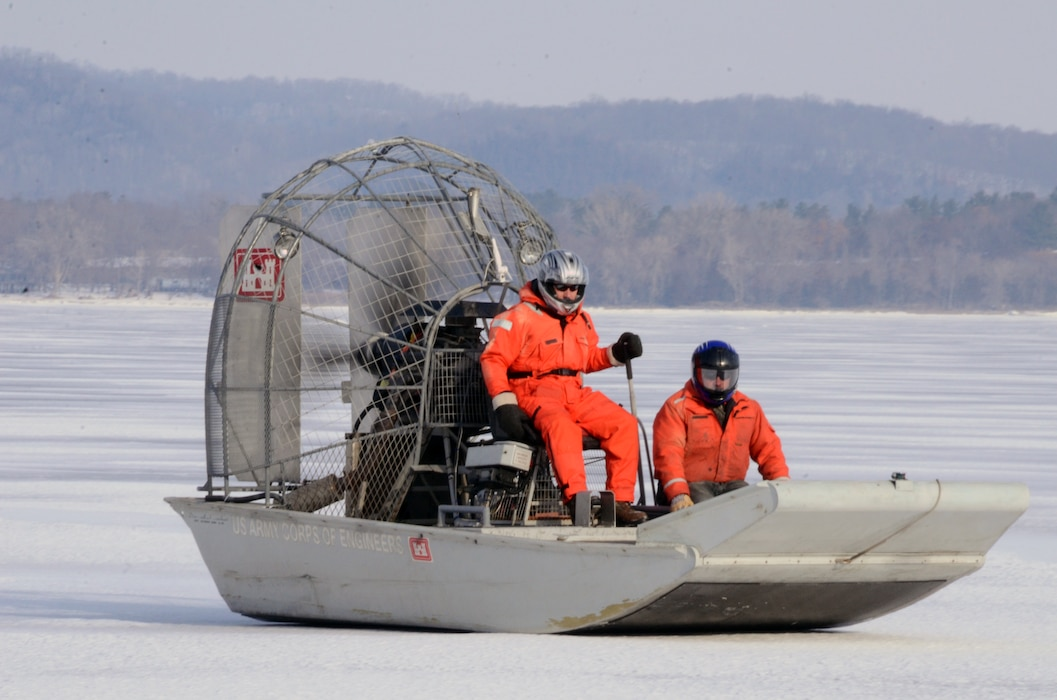 WABASHA, Minn. – U.S. Army Corps of Engineers, St. Paul District employees Al VanGuilder, left, survey technician, and Bill Chelmowski, marine machinery mechanic, use an airboat to  measure ice on Lake Pepin, near Wabasha, Minn., Feb. 13, during the first Mississippi River ice surveys of the year. The district conducts the annual ice surveys to help the navigation industry determine when it is safe to break through the ice. Lake Pepin, located on the Mississippi River between Red Wing and Wabasha, Minn., is used as the benchmark because the ice melts slower in this area due to the lake width and the slower current.