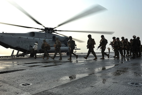 Marines board a CH-53E Super Stallion helicopter, assigned to Marine Medium Helicopter Squadron (HMM) 262, 31st Marine Expeditionary Unit aboard the forward-deployed amphibious assault ship USS Bonhomme Richard (LHD 6)to be transported ashore for exercise Cobra Gold 2013 here, Feb. 13. Cobra Gold is an annual exercise that includes numerous multilateral events ranging from amphibious assaults to non-combatant evacuation operations. The training aims to improve interoperability between the United States, the Kingdom of Thailand, and many other participating countries. The 31st MEU is the only continuously forward-deployed MEU and is the Marine Corps' force in readiness in the Asia-Pacific region.