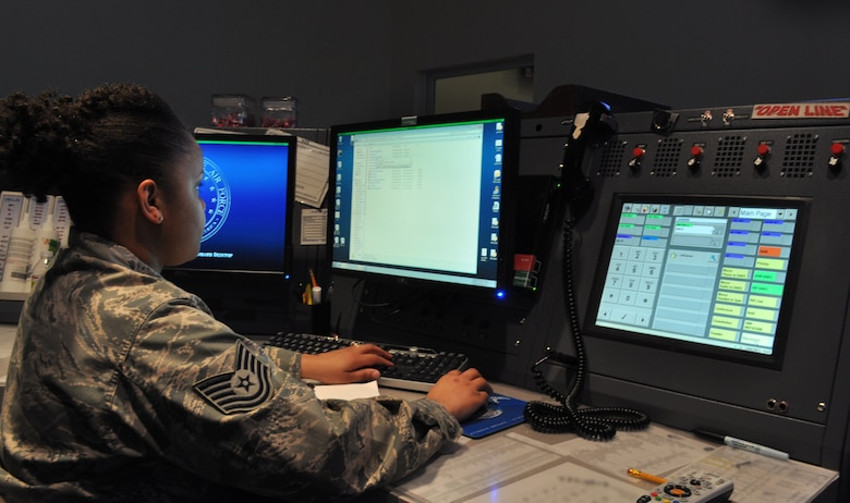 "Tech. Sgt. Lakesha Bailey, 507th Air Refueling Wing command post controller and training manager works from her console here Feb 14. The 137th ARW, Oklahoma Air National Guard and 507th ARW's ""Sooner Control"" command post is the only joint guard and reserve command post with a nuclear mission in the Air Force. (U.S. Air Force Photo by Senior Airman Mark Hybers)"