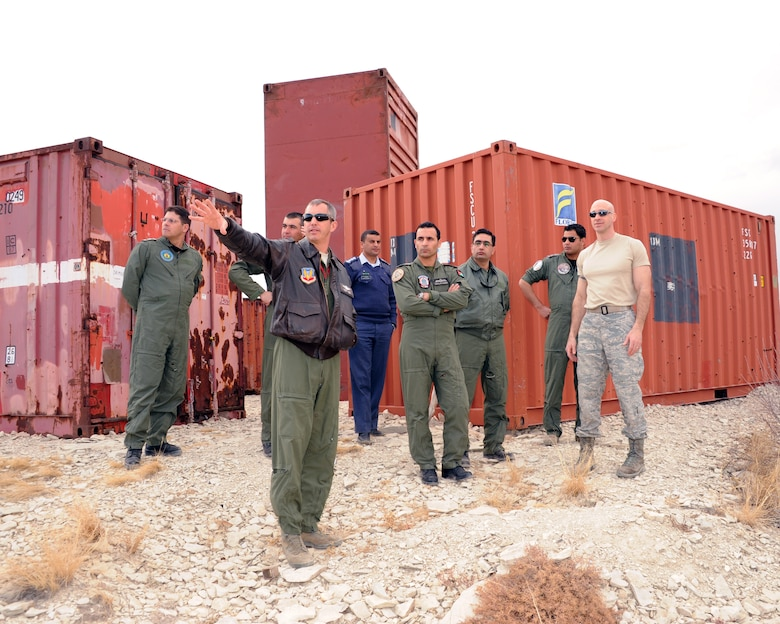 Colorado Air National Guard Lt. Col. Mitchell Neff (front center), chief of safety, 140th Wing, discusses risk mitigation and safety issues on the wing's Airburst Range with Range Commander COANG Lt. Col. John Stevenson (right), 140th Operations Support Squadron, and visiting members of the Royal Jordanian Air Force, Feb. 6, 2013, during the State Partnership Program Aviation Safety Exchange. The group spent a day at the 140th Wing's Airburst Range at Fort Carson, Colo., to watch F-16s drop practice bomb drops and strafe targets at low angle, and have the opportunity to witness how the wing's safety programs work during F-16 missions.  (Air National Guard Photo / Senior Master Sgt. John P. Rohrer)