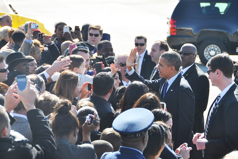 President Barack Obama gives a hi-five during his visit to Dobbins Air Reserve Base, Feb. 14. The president was en-route to the City of Decatur Recreation Center to discuss proposals outlined in his recent state of the union address. (U.S. Air Force photo/James Branch)