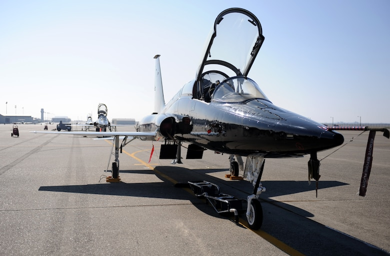 A T-38 Talon jet trainer sits on the flight-line during a pilot rescue exercise on the flight-line at Beale Air Force Base, Calif., Feb. 13, 2013. Beale's Talons are painted black to mirror the U-2 Dragon Lady. (U.S. Air Force photo by Staff Sgt. Robert M. Trujillo/Released)