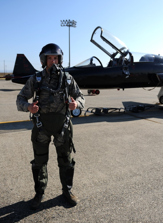 Airman 1st Class Eric Whaley, 9th Civil Engineer Squadron firefighter, poses in front of a T-38 Talon jet trainer on the flight-line at Beale Air Force Base, Calif., Feb. 13, 2013. Whaley portrayed a pilot during a fire department exercise. (U.S. Air Force photo by Staff Sgt. Robert M. Trujillo/Released)