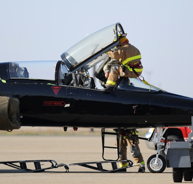 Beale firefighters perform a pilot rescue exercise on the flight-line at Beale Air Force Base, Calif., Feb. 13, 2013. The aircraft used in the exercise is a T-38 Talon jet trainer. (U.S. Air Force photo by Staff Sgt. Robert M. Trujillo/Released)