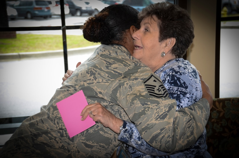 Master Sgt. Tiffany Robinson, 17th Airlift Squadron first sergeant, shares a hug with Mary Maddox during the National Salute a Veteran week, Feb. 12, 2013, at the VA Clinic at Joint Base Charleston – Weapons Station. Volunteers from Joint Base Charleston also visited VA clinics to give Valentine's cards to veterans at the Ralph H. Johnson VA clinic and Trident VA clinic. (U.S. Air Force photo/Staff Sgt. Anthony Hyatt)