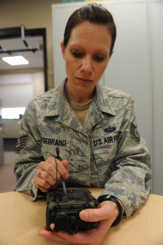 WHITEMAN AIR FORCE BASE, Mo. -- Tech. Sgt. Jessica Hildebrand, 509th Communications Squadron Wing Information Assurance Office NCOIC, operates a simple key loader, Feb. 11. The SKL is used to secure communications. (U.S. Air Force photo/Airman 1st Class Bryan Crane)