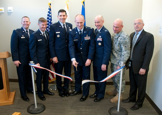 HANSCOM AIR FORCE BASE, Mass. -- (left to right) U.S. Air Force Col. Frank Glenn, Maj. Gen. Craig S. Olson, Lt. Gen. C.D. Moore II, Maj. Aron Potter, Col. Lester A. Weilacher, U.S. Army Col. Charles Samaris and Joe Spangenberger cut the ribbon on the new Mental Health facility attached to the 66th Medical Squadron clinic Feb. 13. Construction on the facility began in May 2012 and will officially open to patients Feb. 26. (U.S. Air Force photo by Mark Wyatt)