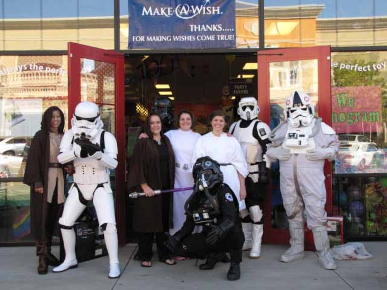 ERDC-CHL Deputy Director Jose Sanchez, second from left, poses with several of his partners in crime at a charity event benefiting the Make-A-Wish Foundation.