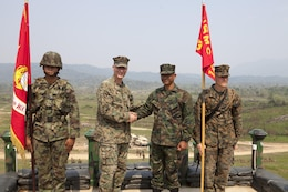 U.S. Marine Lt. Col. Chris P. O'Connor (left center) and Royal Thai Marine Lt. Cmdr. Banjerd Adium shake hands during the opening ceremony Feb. 11 announcing the start of the exercise Cobra Gold 2013 field training exercises in Ban Chan Krem, Kingdom of Thailand. Cobra Gold is a recurring, multinational and multiservice exercise hosted annually by Thailand and developed by the Thai and U.S. militaries. CG 13 also includes humanitarian and civic assistance projects and a staff exercise. Adium is the commanding officer of 3rd Battalion, 1st Infantry, Royal Thai Marines and O'Connor is the commanding officer of 1st Battalion, 3rd Marine Regiment, 3rd Marine Division, III Marine Expeditionary Force.