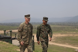 U.S. Marine Lt. Col. Chris P. O'Connor (left) and Royal Thai Marine Lt. Cmdr. Banjerd Adium depart the formation of Thai and U.S. Marines after the conclusion of the opening ceremony Feb. 11 announcing the start of exercise Cobra Gold 2013 field training exercises at Ban Chan Krem, Kingdom of Thailand. Cobra Gold is a recurring, multinational and multiservice exercise hosted annually by Thailand and developed by the Thai and U.S. militaries. CG 13 also includes humanitarian and civic assistance projects and a staff exercise. Adium is the commanding officer of 3rd Battalion, 1st Infantry, Royal Thai Marines, and O'Connor is the commanding officer of 1st Battalion, 3rd Marine Regiment, 3rd Marine Division, III Marine Expeditionary Force.