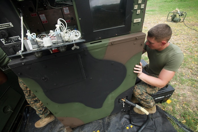 U.S. Marine Lance Cpl. Erick M. Mechelhoff prepares a generator Feb. 10 in Sattahip, Kingdom of Thailand, that will power the tactical water purification system to support operations during exercise Cobra Gold 2013. The exercise includes humanitarian and civic assistance projects, a staff exercise and field training exercises. Joint and multinational training is vital to maintaining the readiness and interoperability of all participating military forces. Mechelhoff is a basic electrician with 9th Engineer Support Battalion, 3rd Marine Logistics Group III Marine Expeditionary Force.
