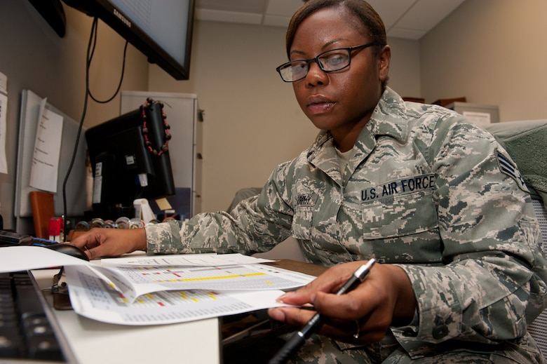 Senior Airman Alexandria Murphy, 432nd Attack Squadron aviation resource manager, reviews flight records in the 432nd ATKS SARM office on Ellsworth Air Force Base, S.D., Jan. 28, 2013. The SARM Airmen are responsible for keeping Ellsworth's MQ-9 Reaper aircrews' training records current to guarantee they are qualified to execute their mission. (U.S. Air Force photo by Airman 1st Class Kate Thornton-Maurer/Released)