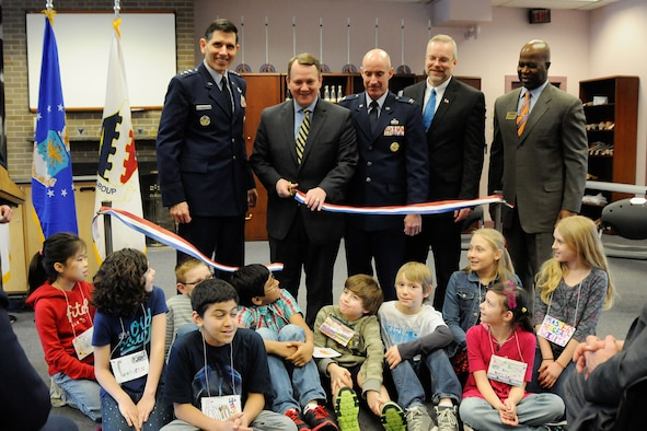 HANSCOM AIR FORCE BASE, Mass. – (left to right) Lt. Gen. C.D. Moore II, Air Force Life Cycle Management Center commander; Massachusetts Lt. Gov. Tim Murray; Col. Lester A. Weilacher, 66th Air Base Group commander; Dr. Peter Holden, Hanscom STARBASE director; and Vic Hayes, 66th Force Support Squadron director, along with Hanscom Middle School fifth graders cut a ribbon signifying the official opening of the Hanscom STARBASE program Feb. 13. STARBASE is a Department of Defense initiative that targets Title I schools and at-risk youth to get them excited about science, technology, engineering and math. (U.S. Air Force photo by Linda LaBonte Britt)