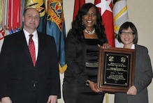 Tonju Butler(center) contracting officer in the U.S. Army Engineering and Support Center, Huntsville's Contracting Directorate poses with Mr. Kim Denver, Deputy Assistant Secretary of the Army for Procurement and the Hon. Ms. Heidi Shyu, Assistant Secretary of the Army for Acquisition, Logistics and Technology during the Secretary of the Army Awards for Excellence in Contracting ceremony Jan. 28.
