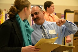 Middle East District's Mo Mostaghim confers with another judge during the annual science fair.