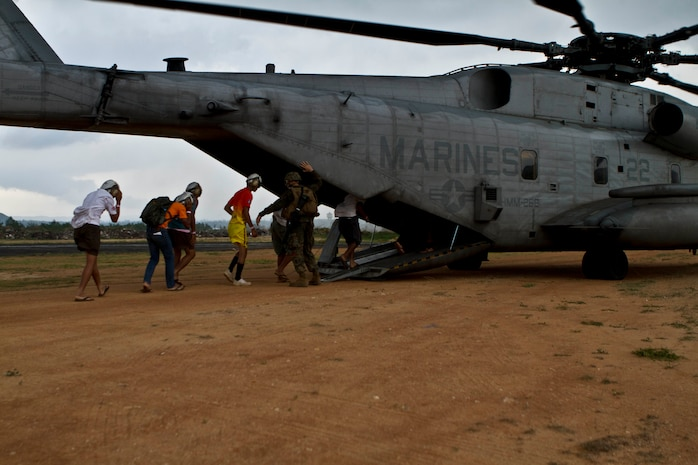 Marines from Combat Logistics Battalion 31, 31st Marine Expeditionary Unit, escort Thai citizens into a CH-53E Super Stallion helicopter from Marine Medium Helicopter Squadron 262 (Reinforced) during a multilateral non-combatant evacuation operation as a part of Cobra Gold 2013 here, Feb. 17. Cobra Gold is the largest multinational exercise in the Asia-Pacific and helps develop the ability of all participants to effectively conduct humanitarian assistance and disaster relief operations. The 31st MEU is the only continuously forward-deployed MEU and is the Marine Corps' force in readiness in the Asia-Pacific region.