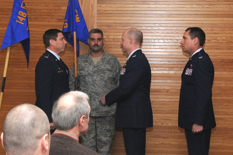 Col. Frank Stokes, 148th Fighter Wing Commander; Senior Master Sgt. Mark Graves, 148FW Operations Group First Sergeant; Col. Gerald Ostern, 148FW Operations Group Commander and Col. Brad Jackson participate in a change of command cereomony on 10 February 2013.  Col Gerald Ostern relinquished command of the Operations Group and Col. Brad Jackson (far right) accepted command during the ceremony which was held at the 148 FW, Duluth, Minn.  (National Guard photo by Senior Airman Sarah Hayes/Released)