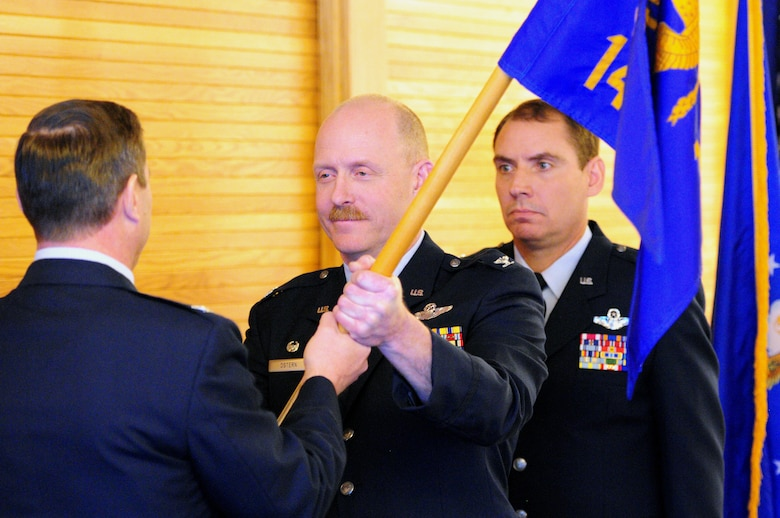 Col. Gerald Ostern (middle), Operations Group Commander relinquishes command to Col. Frank Stokes (far left), 148th Fighter Wing Commander during a change of command ceremony on February 10, 2013.  Col Brad Jackson (far right) accepted command of the Operations Group during the ceremony which was held at the 148 FW, Duluth, Minn.  (National Guard photo by Senior Airman Sarah Hayes/Released)