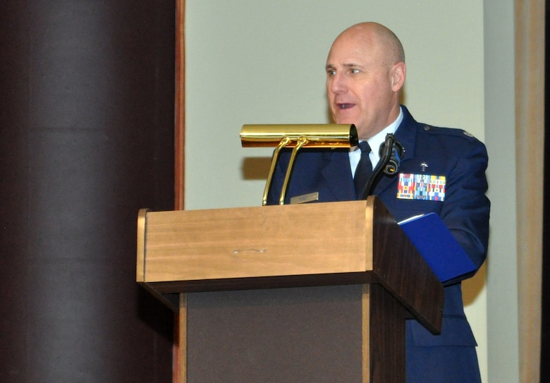 Chaplain (Lt. Col.) Victor Toney, 55th Wing chaplain, shares a few words before providing the invocation at the inaugural Salute to America's Heroes dinner at the Omaha Ramada Inn Feb. 16. More than 50 wounded warriors and their families from around the Midwest attended the event. (Photo by Ryan Hansen)