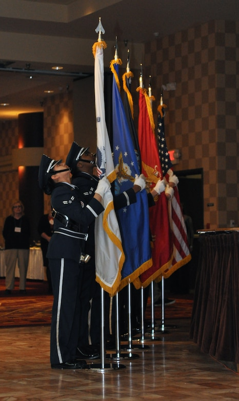 The Offutt Honor Guard posts the colors from each branch of military service as well as the American flag to mark the beginning of the inaugural Salute to America's Heroes dinner at the Omaha Ramada Inn Feb. 16. Attendees were given two nights at a hotel, tickets to the Durham Museum, Joslyn Art Museum and Omaha Children's Museum, and passes to the Coco Key indoor water resort all for free thanks to the Wounded Warrior Family Support Program. (Photo by Ryan Hansen)