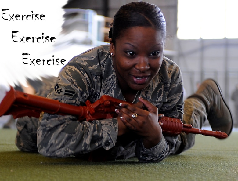 Airman 1st Class Wintera Jones, 28th Force Support Squadron personnel technician, practices high crawling during a 28th Mission Support Group deployment readiness exercise in the Pride Hangar at Ellsworth Air Force Base, S.D., Feb. 14, 2013. The 28th Security Forces Squadron hosted the exercise which focused on cover and concealment, M-4 carbine and M-9 handgun familiarization and what to do in the event of an active shooter scenario. (U.S. Air Force photo illustration by Airman Ashley J. Thum/Released)