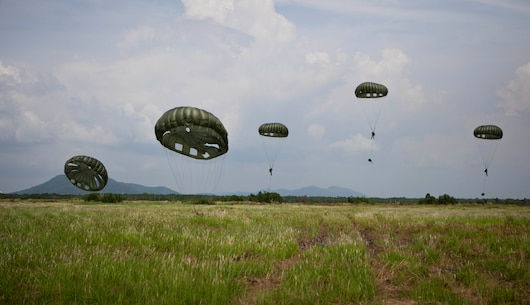 Royal Thai Marines with 1st Long Range Reconnaissance Platoon connect with the ground after parachuting out of a C-130 Hercules during bilateral parachute jump training as part of Cobra Gold 2013 here, Feb. 18. Thailand and the United States are committed to working together in areas of common interest for the stabilization of regional security. The 31st MEU is the only continuously forward-deployed MEU and is the Marine Corps' force in readiness in the Asia-Pacific region.