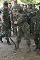Lance Cpl. Katelyn M. Hunter, a combat photographer with the command element, 31st Marine Expeditionary Unit, and a native of Arcadia, Fla., handles a king cobra snake under the supervision of a Royal Thai Marine during a jungle survival class as a part of Cobra Gold 2013 here, Feb. 20. Cobra Gold demonstrates the resolve of the U.S. and participating nations to increase interoperability, and promote security and peace throughout the Asia-Pacific region. The 31st MEU is the only continuously forward-deployed MEU and is the Marine Corps' force in readiness in the Asia-Pacific region.