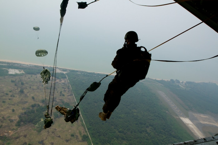 U.S. and Royal Thai Marines parachute out of a KC-130J Hercules aircraft while conducting bilateral aerial delivery training during exercise Cobra Gold 2013 near Utapao Royal Thai Navy Air Field, Kingdom of Thailand, Feb. 15. The Marines participated in the training to enhance the two nations' combat readiness and military-to-military cooperation. The U.S. Marines are with 3rd Marine Reconnaissance Battalion, 3rd Marine Division, III Marine Expeditionary Force.