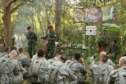 Royal Thai Army Special Forces Master Sgt. 1st Class Sanchai Srioutai, center, teaches Thai and U.S. Army soldiers about jungle survival Feb. 17 at Camp Akatosrot, Phitsanulok province, Kingdom of Thailand, as part of exercise Cobra Gold 2013. Royal Thai Army students are with 7th Regiment, 7th Division, 3rd Region. U.S. soldiers are with Baker Company, 2nd Battalion, 9th Infantry Regiment, 1st Armored Brigade Combat Team, 2nd Infantry Division. Cobra Gold, in its 32nd iteration, is a multinational exercise that promotes regional prosperity, security and cooperation among partner militaries.