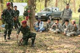 Royal Thai Army Special Forces Master Sgt. 1st Class Thong Nimnuan, center, demonstrates how to safely handle a cobra during a jungle survival class Feb. 17 at Camp Akatosrot, Phitsanulok province, Kingdom of Thailand, as part of exercise Cobra Gold 2013. Royal Thai Army students are with 7th Regiment, 7th Division, 3rd Region. U.S. soldiers are with Baker Company, 2nd Battalion, 9th Infantry Regiment, 1st Armored Brigade Combat Team, 2nd Infantry Division. Exercise Cobra Gold is the largest multinational exercise in the Asia-Pacific region and provides the Kingdom of Thailand, United States, Singapore, Japan, Republic of Korea, Indonesia, Malaysia and observer nations, an opportunity to maintain relationships and enhance interoperability.