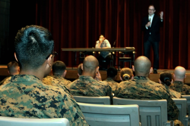 "Marines wait for a one-man play titled ""Rum and Vodka"" to begin, as Bryan Dorries, the artistic director of the production, introduced Adam Driver, an actor who performed an excerpt from the monologue at the base theater Feb. 14."