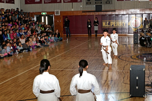 Students from the Shunan International Children's Club performs a karate demonstration during a cultural exchange event inside the Matthew C. Perry High School Gym here, Feb. 11, 2013.