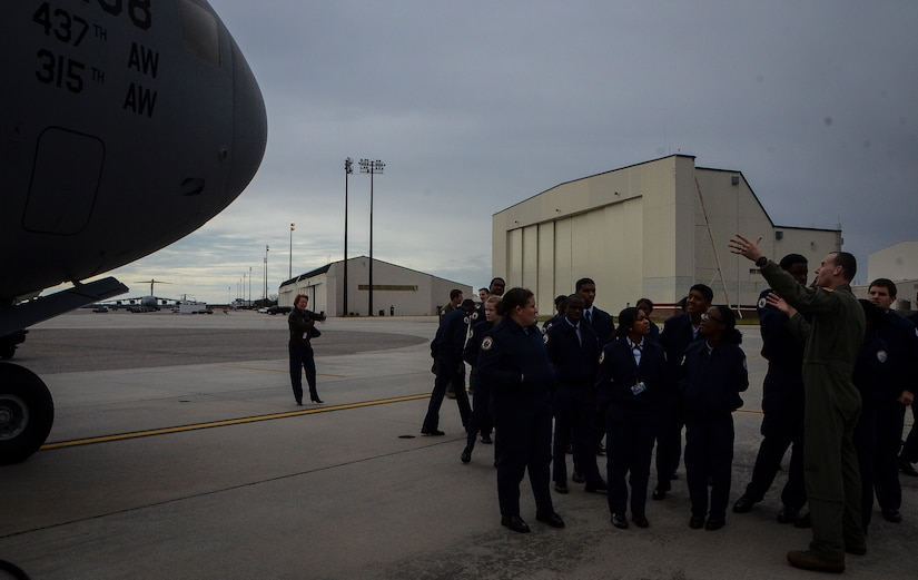 Captain. C.J. Burdon, 16th Airlift Squadron pilot, explains the capabilities of the C-17 Globemaster III to U.S. Air Force Junior Reserve Officer Training Corps students from R.B. Stall High School Feb. 19, 2013, at Joint Base Charleston – Air Base, S.C.  More than 20 students visited the air base to get a firsthand experience of what Airmen do on a day-to-day basis. These tours help endorse strong community ties to the local population and help recruit future leaders of tomorrow's Air Force. (U. S. Air Force photo/Airman 1st Class Jared Trimarchi)