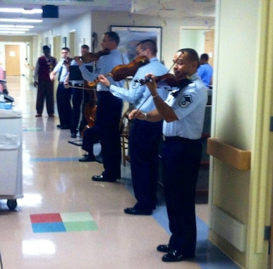The Air Force Strings serenade the patients and staff at Baltimore's VA Hospital in observance of National Salute Week (AF photo by Tech. Sgt. Ni Santiago)