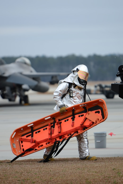 Firefighters with the 169th Civil Engineering Squadron at McEntire Joint National Guard Base, S.C., respond to a training scenario to remove a pilot from the cockpit of an F-16 Block 52 figher jet Feb. 8, 2013. The aircrew extraction training measures how quickly and safely emergency rescue personnel can remove an incapacitated pilot from a plane during an Operational Readiness Exercise. The 169th Fighter Wing is training for an upcoming Operational Readiness Inspection later this year. (National Guard photo by Tech. Sgt. Caycee Watson/Released)