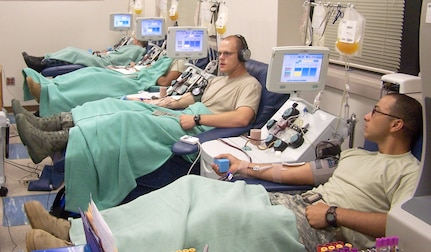 "Soldiers, Sailors and Airmen become ""blood brothers and sisters"" during their platelet donation at the Akeroyd Blood Donor Center. (Photo by Mark Salcedo, Akeroyd Blood Donor Center)"