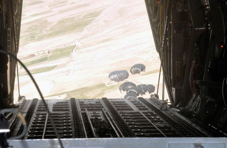 An airdrop is released by the 772nd Expeditionary Airlift Squadron Feb. 14, 2013, above southern Afghanistan. Many 317th Airlift Group Airmen are deployed with 772nd EAS. The airdrop contained food and fuel for troops at a remote location. (U.S. Air Force photo by Capt. Tristan Hinderliter/Released)