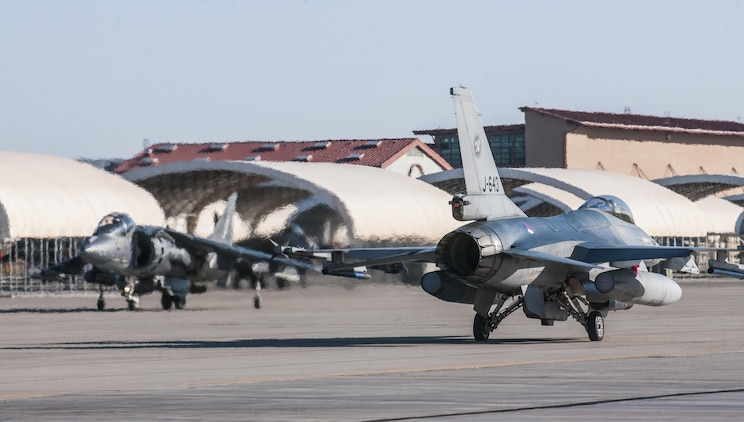 An F-16 from the Royal Netherlands Air Force prepares for takeoff along with AV-8B Harriers of Marine Attack Squadron 214 at Marine Corps Air Station Yuma, Ariz. Feb. 7, 2013. The RNLAF detachment is conducting aviation training in Yuma for three weeks before returning to the Netherlands.