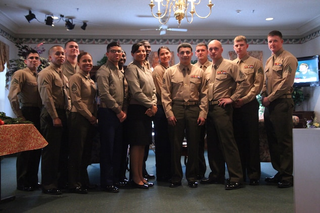 Twenty Marines from the Air Station and Marine Corps Recruit Depot Parris Island spent time speaking and enjoying a meal at River Oaks Residential Care in Beaufort, S.C., Valentines Day. Each Marine would deliver a rose to one of the residents and escort them to the dining area for lunch.