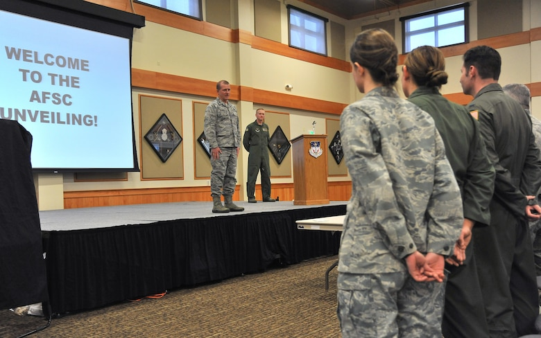 Col. Robert Stanley, 341st Missile Wing commander, talks to Team Malmstrom officers before receiving their new career during an Air Force Specialty Code unveiling at the Grizzly Bend on Feb. 14. Nearly 20 missileers received a new AFSC under nuclear, space, air craft maintenance or cyber operations. The Air Force split the space and missile career field to give officers more focused development in their respective areas. The split, affecting more than 3,000 officers Air Force-wide, aims to strengthen the nuclear enterprise. (U.S. Air Force photo/John Turner)