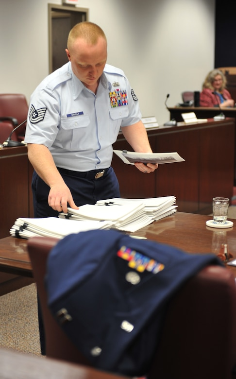 WHITEMAN AIR FORCE BASE, Mo. -- Tech. Sgt. Matthew Shively, 509th Bomb Wing Legal Military Justice NCO in charge, prepares for court during his shift at the Whiteman AFB court room, Feb. 12, 2013. Shively strives to provide the best possible support to Team Whiteman works toward accomplishing his goals. (U.S. Air Force photo/Heidi Hunt)