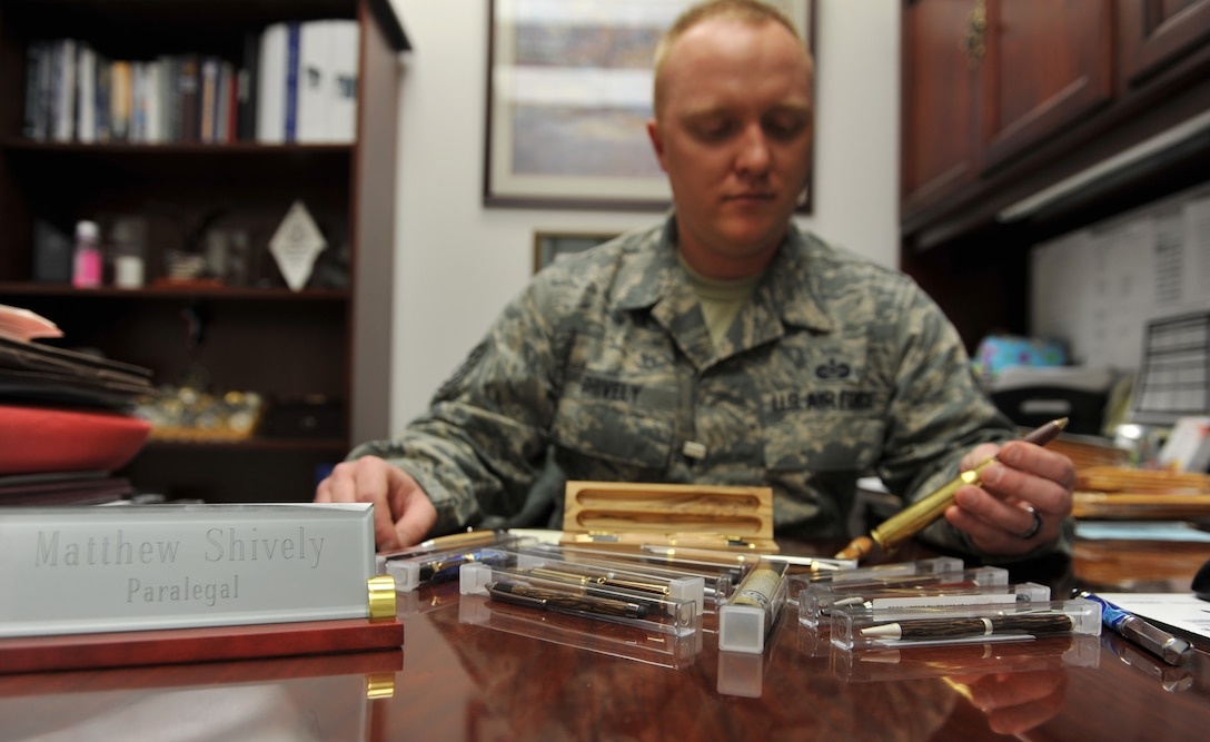 WHITEMAN AIR FORCE BASE, Mo. -- Tech. Sgt. Matthew Shively, 509th Bomb Wing Legal Military Justice NCO in charge, displays his writing pens that he makes as a hobby, Feb. 19, 2013. Shively sells the pens online and has sold 34 thus far. (U.S. Air Force photo/Heidi Hunt)