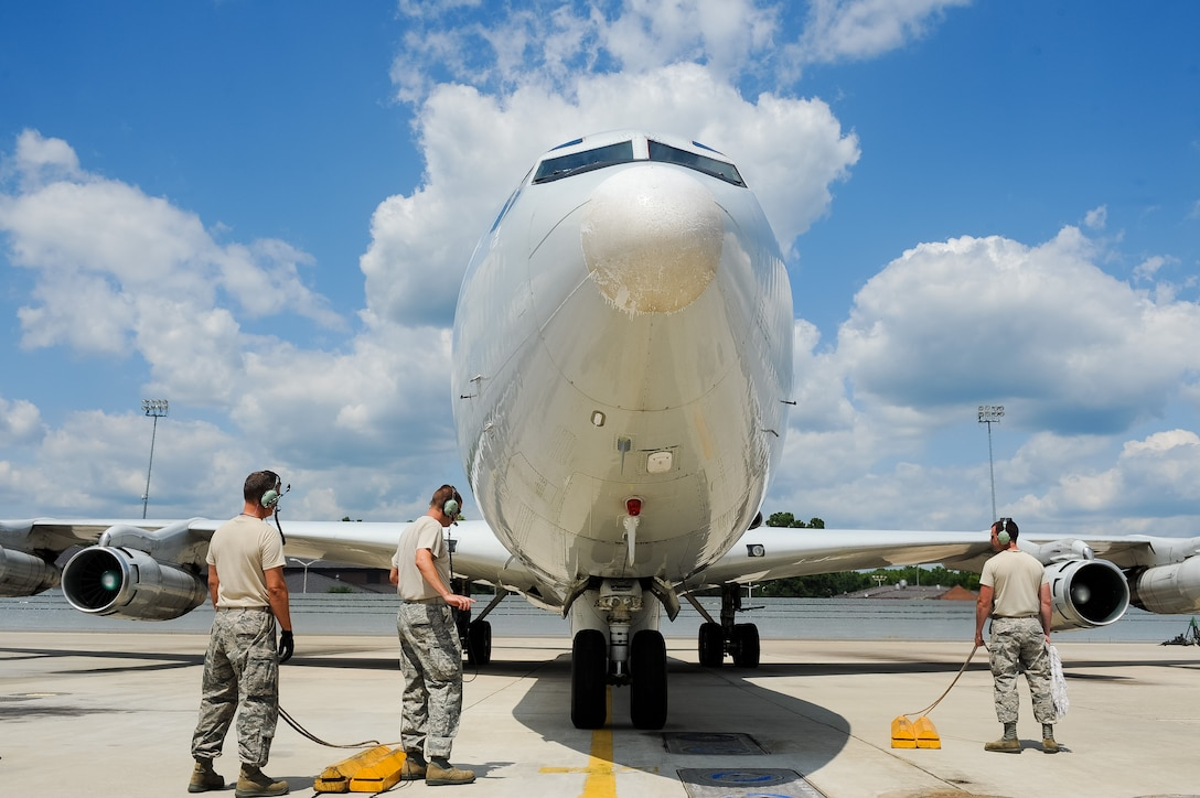 Team JSTARS aircraft crew chiefs recover an E-8C Joint STARS returning from a mission in support of Exercise Iron Dagger at Robins Air Force Base, Ga., June 15, 2012.  The 116th and 461st Air Control wings created the first ever Iron Dagger exercise which involved more than $1 billion worth of joint service assets from four different states and included Air Force, National Guard, Army, Navy and U.S. Customs and Border Protection personnel and equipment. (National Guard photo by Master Sgt. Roger Parsons/Released)