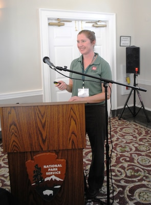 Jessica Spencer (left) of the Invasive Species Management Branch describes two new plants that have recently invaded Jacksonville, Fla. –Old World climbing fern and Saltcedar – at the 2013 Timucuan Science and History Symposium Jan. 25.