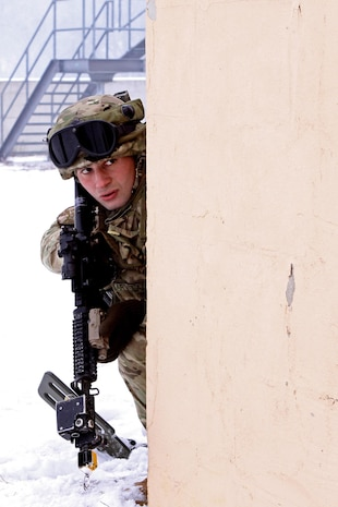 A Soldier assigned to Georgian Armed Forces, 33rd Battalion pulls security on the corner of a building during the close quarter combat portion of a cordon and search exercise, recently in Hohenfels, Germany. These soldiers are completing their mission readiness exercise as the final event of the latest rotation of the Georgia Deployment Program-International Security Assistance Force hosted and executed by Marine Forces, Europe, Marine Corps Security Cooperation Group and U.S. Army soldiers stationed at the Joint-Multinational Readiness Center in Hohenfels, Germany. The GDP-I was started in 2009 to provide security cooperation training to the GAF in preparation for their deployments to Afghanistan where they are responsible for their own area of responsibility and work closely with U.S. Marines in the region.