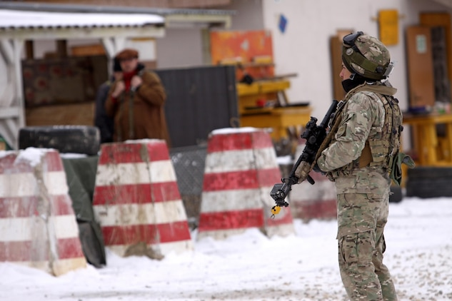 A Soldier assigned to Georgian Armed Forces, 42nd Battalion patrols through a simulated village a cordon and search exercise, recently in Hohenfels, Germany. These soldiers are completing their mission readiness exercise as the final event of the latest rotation of the Georgia Deployment Program-International Security Assistance Force hosted and executed by Marine Forces, Europe, Marine Corps Security Cooperation Group and U.S. Army soldiers stationed at the Joint-Multinational Readiness Center in Hohenfels, Germany. The GDP-I was started in 2009 to provide security cooperation training to the GAF in preparation for their deployments to Afghanistan where they are responsible for their own area of responsibility and work closely with U.S. Marines in the region.